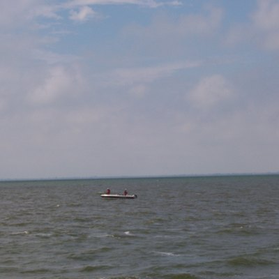 People fishing near the shore of Lake Winnebago. Picture taken from the Stockbridge Harbor, Calumet County, Wisconsin. I took this image myself on August 6, 2006 (camera date set wrong).