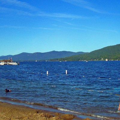 Lake George, Ny, Usa, From Village Beach At Its South End. Shelving Rock, Buck Mountain And Pilot Knob In Distance.