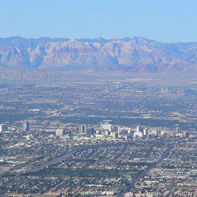 Downtown Las Vegas, Nevada and Red Rock Canyon behind, seen from Frenchman Mountain