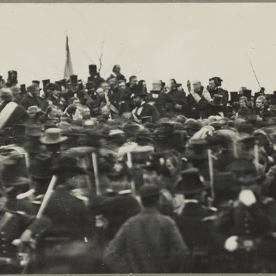 Abraham Lincoln at the dedication of the Soldiers' National Cemetery in Gettysburg, Pennsylvania. Lincoln is slightly left of center, just behind the mass of blurry people, facing the camera, head slightly down and tilted to his right (camera left). On this web page, click on the numeral 3 for the third photo. Mouse over the people around Lincoln and it will identify several other people.