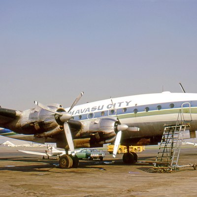 Lockheed L-049 Constellation N90823 of McCulloch Properties weraing Lake Havasu City titles at Long Beach Airport Clifornia in 1971