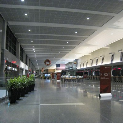 Logan Airport's Terminal A at night.
