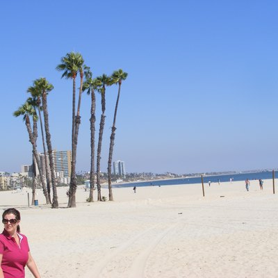 Girl in red top walking on Long Beach