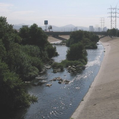 Los Angeles River, looking east, downstream, from the Riverside/Zoo Drive bridge. The bridge in the background is Interstate 5, and the office buildings are in downtown Glendale. This is one of the only parts of the river which does not have a concrete bottom.
