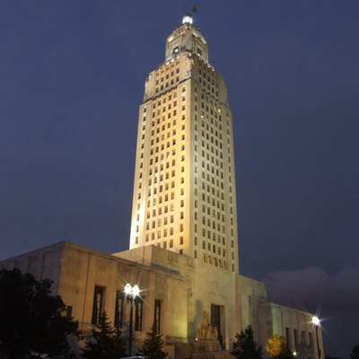 The Louisiana State Capitol building in Baton Rouge, Louisiana at night.