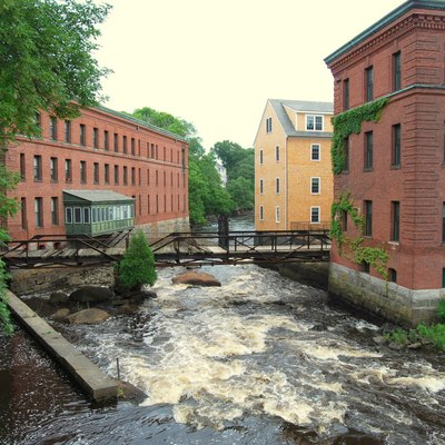 Lower Mills Village, Massachusetts, spanning both sides of the Neponset River between Milton (on the right) and City of Boston (Dorchester) (on the left). These buildings were once part of the Walter Baker Chocolate Factory.