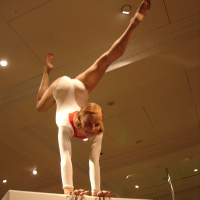 Photograph of wax sculpture of gymnast Olga Korbut on a balance beam at Madame Tussauds, London