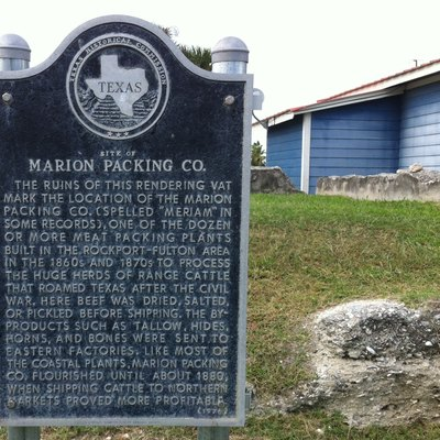In Fulton Texas, a sign marking the site of old meatpacking plant. There had been many slaughterhouses in this town, this is only remaining foundation.
