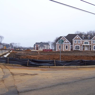 McMansions under construction at the corner of Buckley Rd and Blueberry Hill in Marlboro Township, New Jersey.