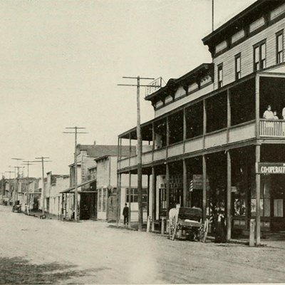 Scanned image of a street scene in Marysville, Washington, showing the Marysville Cooperative Association and the Marysville Hotel to the right.