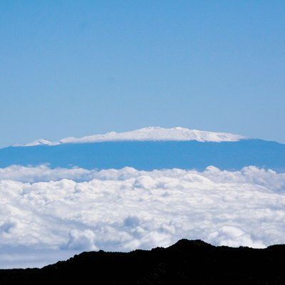 The view of Mauna Kea from the summit of the Haleakala Volcano on the island of Maui