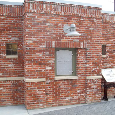 Part of the Meridian Heritage Pavilion in the Meridian City Hall Plaza. Bricks from the original creamery were used to construct the building, and the Challenge Butter smokestack door, which is spotlighted, now covers a time capsule that will be opened in 2033.