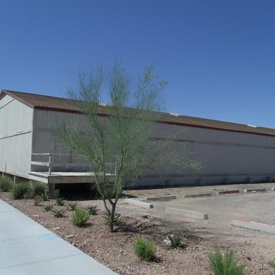 Housing Storage Supply Warehouse at Williams Air Force Base (now Arizona State University at the Polytechnic campus). The housing supply warehouse was constructed in December 1941 by Del E. Webb Construction Company. The housing supply warehouse is significant for its association with the initial development and construction at Williams Air Force Base which is the land in which Phoenix-Mesa Gateway Airport and the Arizona State University at the Polytechnic campus are now located. Listed in the National Register of Historic Places – 1995. Reference 95000746