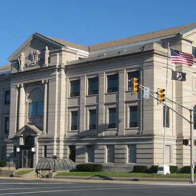 Front and western side of the Michigan City Courthouse, located on the southeastern corner of the junction of Michigan Boulevard (U.S. Route 12) and Washington Street in downtown Michigan City, Indiana, United States. It was built in 1909.