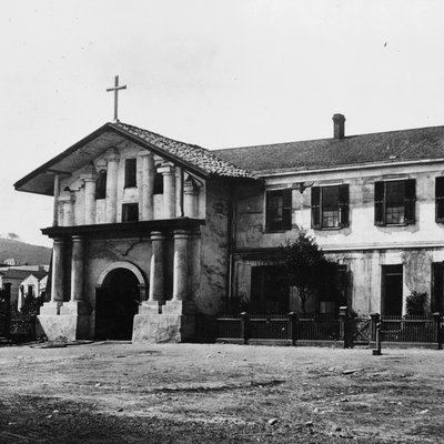 A view of Mission San Francisco de Asis (Mission Dolores) on Dolores Street in San Francisco, California — between 1880 and 1902.