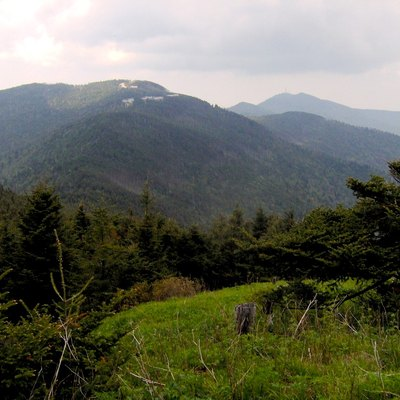 Mount Mitchell (left, foreground) and Clingmans Peak (right, background, with the antennae) in the Black Mountains of Yancey County, North Carolina, in the southeastern United States. The view is south from Mount Craig.