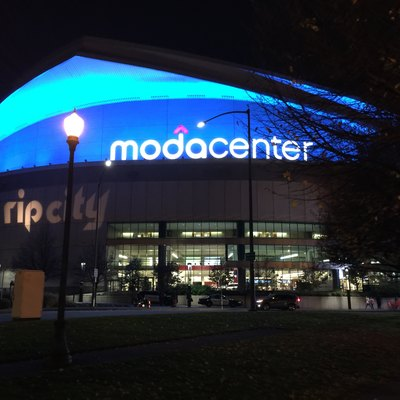 Moda Center, home of the Portland Trail Blazers National Basketball Association basketball team, lit up at night on November 11 (Veterans Day), 2016. This photograph was taken by Parker Knight.