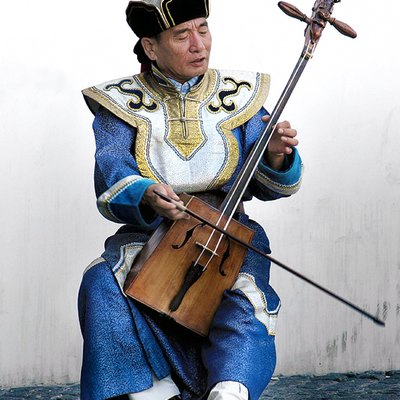 Sambuugiin Pürevjav Of Altai Khairkhan (An Overtone Singing Ensemble From Mongolia) Playing A Morin Khuur Near Centre Georges Pompidou In 2005.