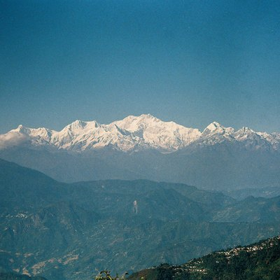 I had taken this photo of Mt. Kanchenjunga or Kanchenzdonga with my manual camera. Its a view of Mt. Kanchenjunga as seen from Darjeeling town with visible Darjeeling Tea gardens. Mt. Kanchenjunga is the world's third highest peak with an elevation of 8,586 m. Enjoy the photo, use it, but don't forget to credit it!