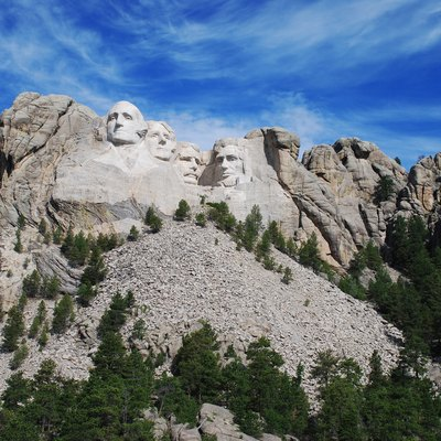 Mount Rushmore with the morning sun shining on the faces of the monument.