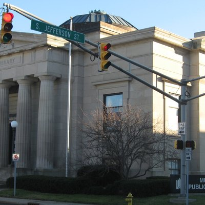 Front and western side of the Muncie Public Library, located at 301 E. Jackson Street in Muncie, Indiana, United States. A Carnegie library built in 1903, it is listed on the National Register of Historic Places.