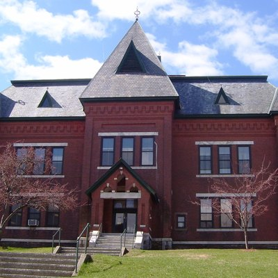 The Municipal Center, or Town Hall, on Vermont Route 30 in Brattleboro, Vermont, was built in 1884 in the Gothic Revival style, orginally for use as the town's high school, which it remained until 1951. It is located within the Brattleboro Downtown Historic District. (Source: