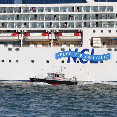 The pilot boat Mystic approaches the Norwegian Dawn cruise liner in Boston Harbor. Since the cruise ship was exiting the harbor, perhaps the pilot boat was coming to pick up the pilot.