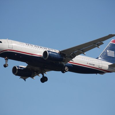 A US Airways (formerly America West) Airbus A320-232, tail number N647AW, landing at Vancouver International Airport