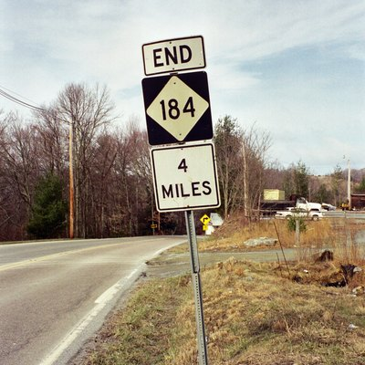 Picture I took back in 2001 showing the unique End Sign for North Carolina Highway 184, going to end in four miles (somewhere up on Beech Mountain). Picture taken in Banner Elk, North Carolina.