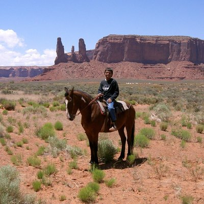 Navajo young boy on horse - working as guide for tourists - Monument Valley - Arizona