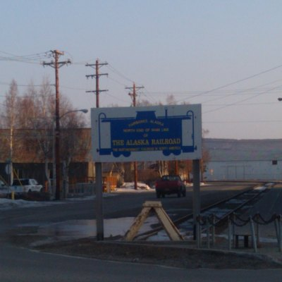 Sign in downtown Fairbanks, Alaska, noting the north end of the main line for the Alaska Railroad. To the right (out of the shot) is the Aurora Building, which houses the Fairbanks Daily News-Miner, and the former railroad depot, which was replaced in 2005.