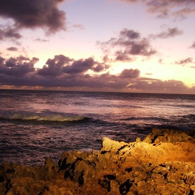 Floodlit lava rock at sunset at Turtle Bay Resort on Oahu's North Shore