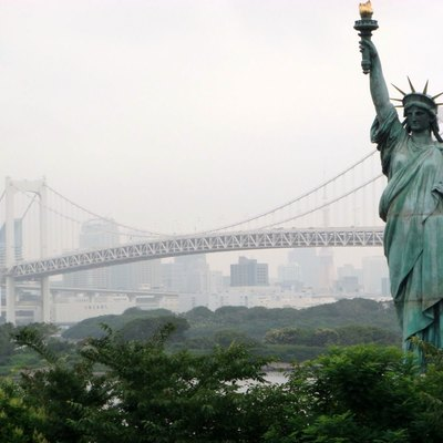 The replica Statue of Liberty in Odaiba, Rainbow Bridge is behind it