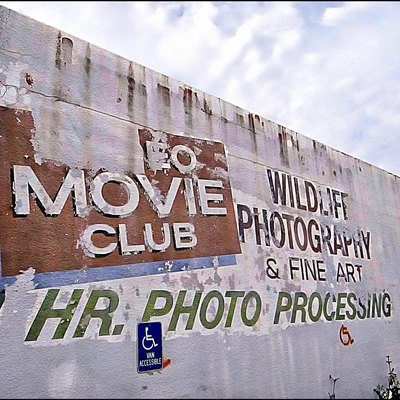 Faaded photo movie and art shop sign, Alice, Texas