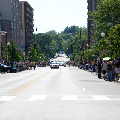 Looking west down P Street NW from Dupont Circle. The 2000 and 2100 blocks can be seen in the photograph. The P Street Bridge is just visible in the distance, between the trees. This image was captured just before the start of the 2012 Capital Pride gay and lesbian parade.