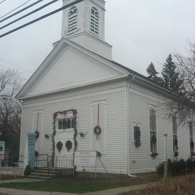 Front of Peninsula United Methodist Church in the Peninsula Village Historic District, located along Main Street (State Route 303) at its intersection with Akron-Peninsula Road in Peninsula, Ohio, United States.