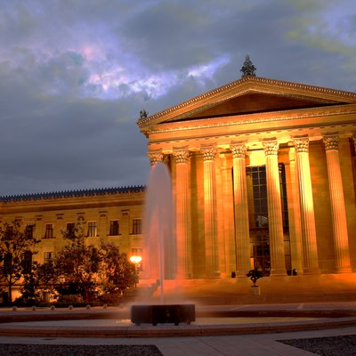 The front facade of the Philadelphia Museum of Art at night.