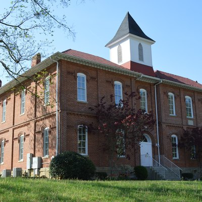 Front and eastern side of the Pikeville College Academy Building, located on College Street in Pikeville, Kentucky, United States. Built in 1890, it is listed on the National Register of Historic Places.