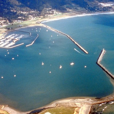 Aerial view of Pillar Point Harbor in San Mateo County, California, USA. The communities of Princeton and El Granada are visible on the shore at the top of the photograph. The U.S. Army Corps of Engineers constructed the breakwaters and harbor. View is to the east.
