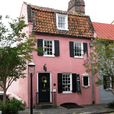 The Pink House, built circa 1712, in Charleston, South Carolina, USA. The house is listed on the National Register of Historic Places as a contributing building in the French Quarter District. As was by then typical of the Architecture of Bermuda, the house was built of limestone from Bermuda (Charleston had been settled from Bermuda under William Sayle in the 1670s, and Bermudians retained close links with the city up to American independence).