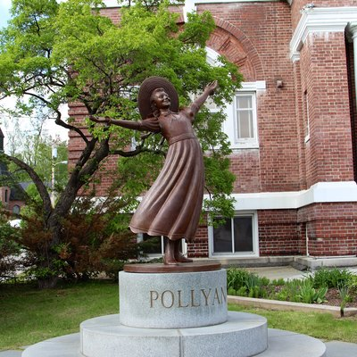 Bronze statue of Pollyanna in front of the public library of Littleton, New Hampshire.