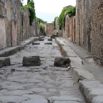 Pompeii Waterway. Notice the stepping stones placed periodically across the waterway.