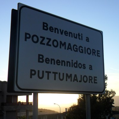 The sign at the entrance of Pozzomaggiore in Sardinia (Italy)