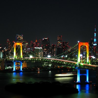 Rainbow colored Rainbow Bridge at night. Tokyo sight from Odaiba island.