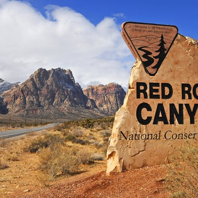 The stone Red Rock Canyon National Conservation Area entrance sign — on Nevada State Route 159 near Blue Diamond, Clark County, southern Nevada.