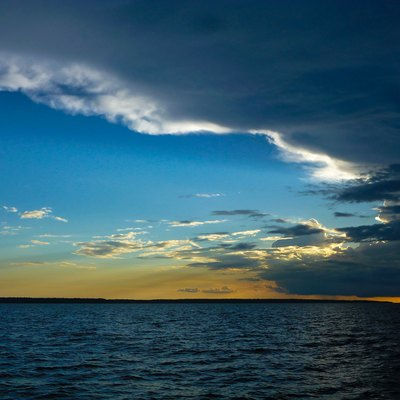 The sun sets behind some clouds on the Rio Negro river, near Manaus in Brazil.