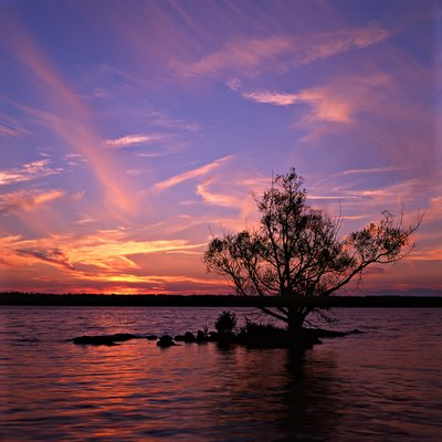 Sunset over one of the smallest of the Thousand Islands. Shot on 6x6 cm Fuji Velvia with a Mamiya C-series twin-lens reflex camera.