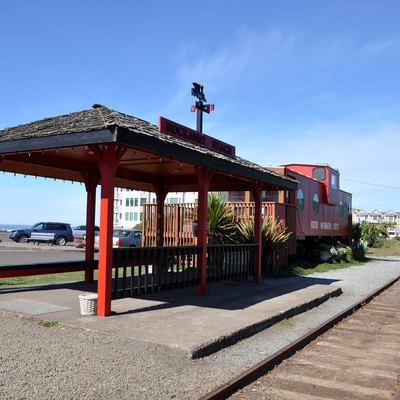 Visitor information center at Rockaway Beach, Oregon, in the United States. The building, a railroad caboose, is just off U.S. Highway 101 in the middle of town.