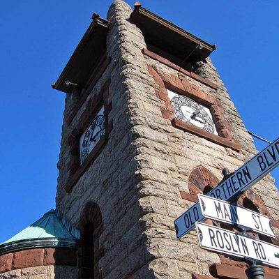 Stone clock tower at junction of Main Street and Old Northern Boulevard in Roslyn, NY, USA