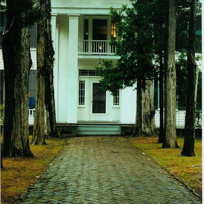 "Front walk and entrance of Rowan Oak, the home of Nobel laureate and American novelist William Faulkner in Oxford, Mississippi. It is now owned and maintained by the University of Mississippi as a museum. One of the oldest structures in Oxford, this Greek Revival house on Old Taylor Road was built in the 1840s by a Colonel Shegog. Faulkner bought the crumbling house, then known as the ""Bailey Place"" in 1930 and promptly renamed it, then slowly refurbished it. Faulkner's daughter sold Rowan Oak to the university in 1972."